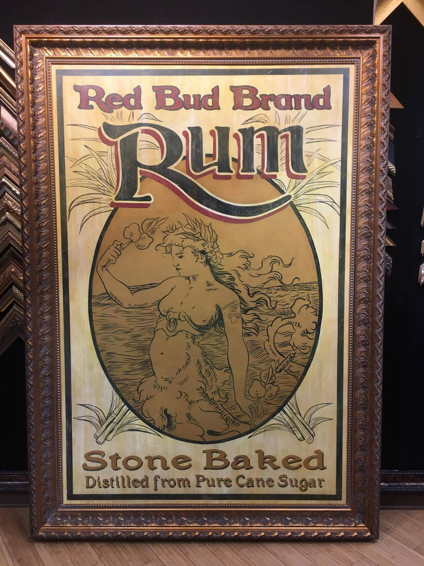 Faux antiqued Red Bud Rum label
